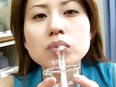 lusty oriental chickj drinks semen from a glass