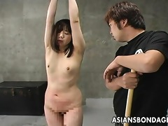 oriental hottie is fastened up and caned hard