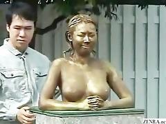 green japanese garden statue has scoops felt up
