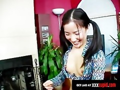 oriental hotty in pigtails plays with toys