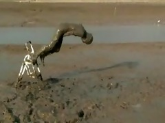 beauty diving headfirst into unfathomable mud