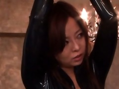 oriental sex serf in latex receives cunt vibrated