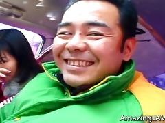 sexy oriental hottie in car having enjoyment