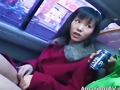 sexy oriental sweetheart in car having pleasure