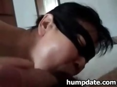 oriental wife wearing a mask and sucks schlong