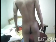 korean chap strips in his room