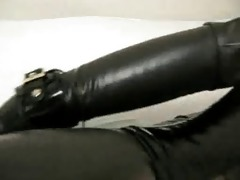 cutie in rubber with bag on head and fake penis