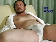older oriental lad all alone at home