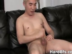 sexy oriental guy jerking off on the sofa