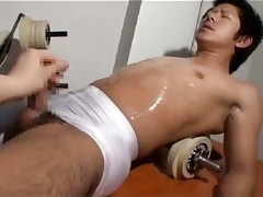 stud stroking his oriental allies cock in gym