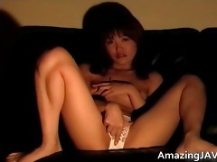 breasty oriental chick masturbating on daybed