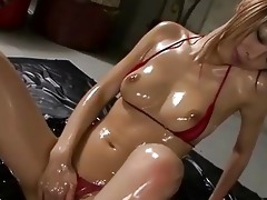 oiled up asian honey receives facialed