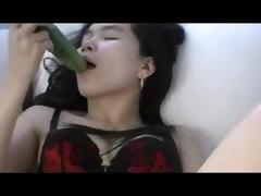 oriental shoves a cucumber up her bushy cum-hole