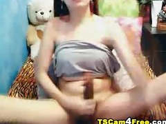 t-girl plays with massive rod