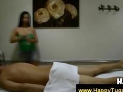oriental masseuse handles a undressed boy
