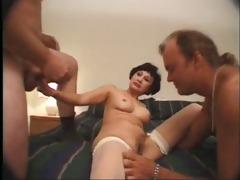 older oriental woman strokes males on hotel daybed