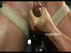 dark stud is gagged and fastened up